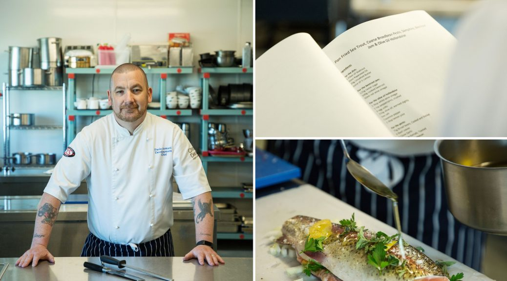 Chef in kitchen with recipe and prepared dish. Commercial corporate photography dublin www.1image.ie
