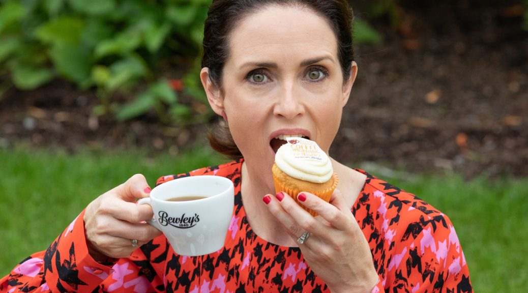 Maia Dunphy eating a bun. Press PR & Event Photographers Dublin www.1image.ie
