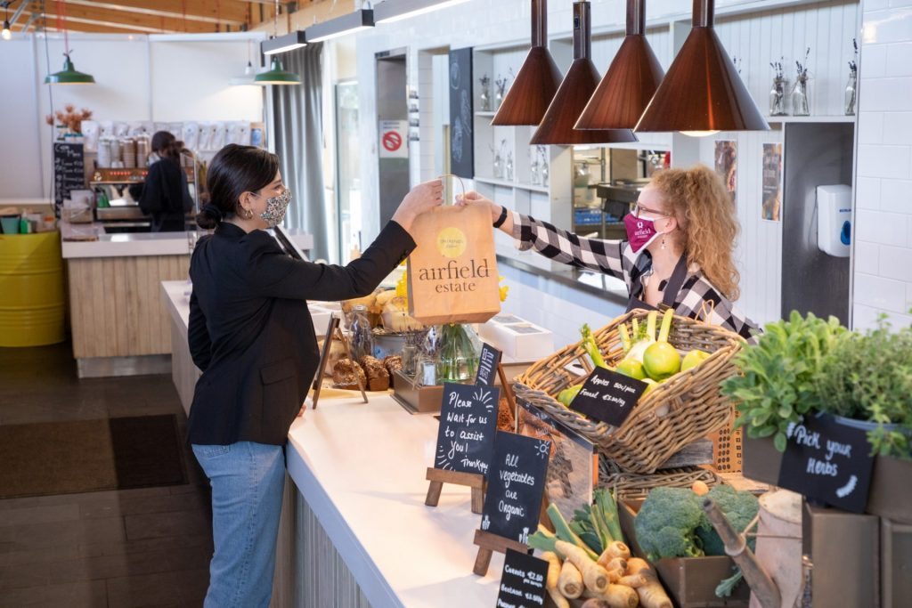 Airfield Estate Farm Shop Press and PR Photography featuring customer and shop assistant with freshly grown farm produce